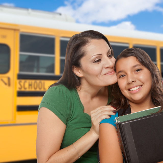 """Hispanic Mother and Daughter Near School Bus."" stock image"