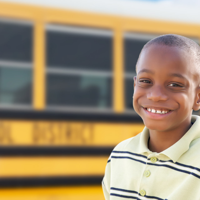 """Young African American Boy Near School Bus"" stock image"