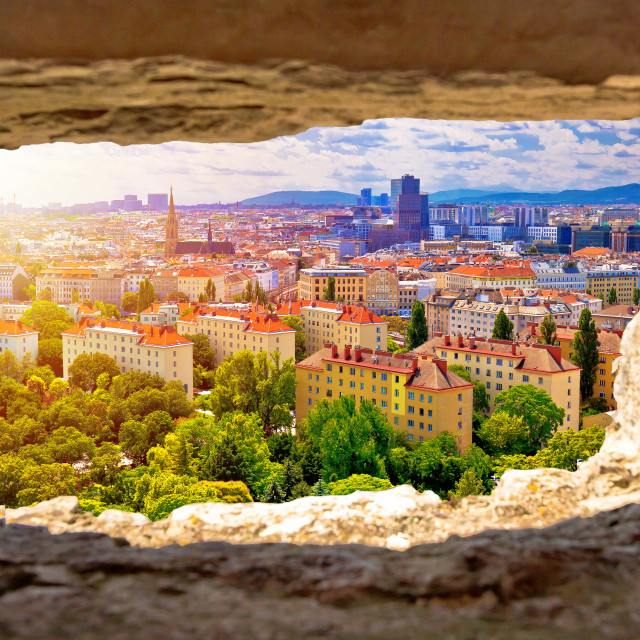 """Vienna cityscape and sun haze view through stone window"" stock image"