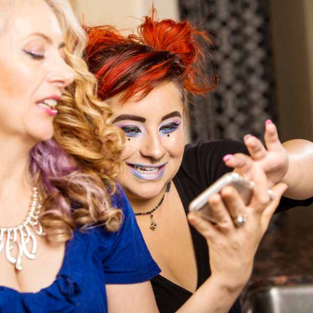 """Mother Daughter Share Phone"" stock image"