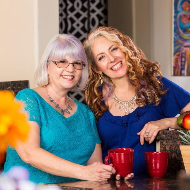 """Smiling Women in Kitchen"" stock image"