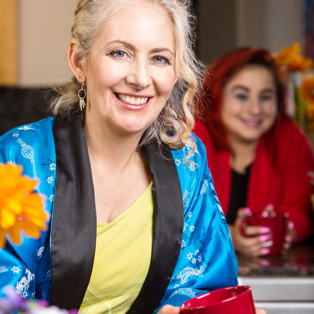 """""""Smiling Woman in Kitchen"""" stock image"""