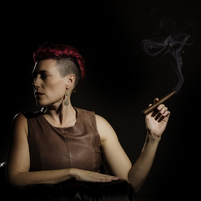 """Modern Woman with a Lit Cigar"" stock image"