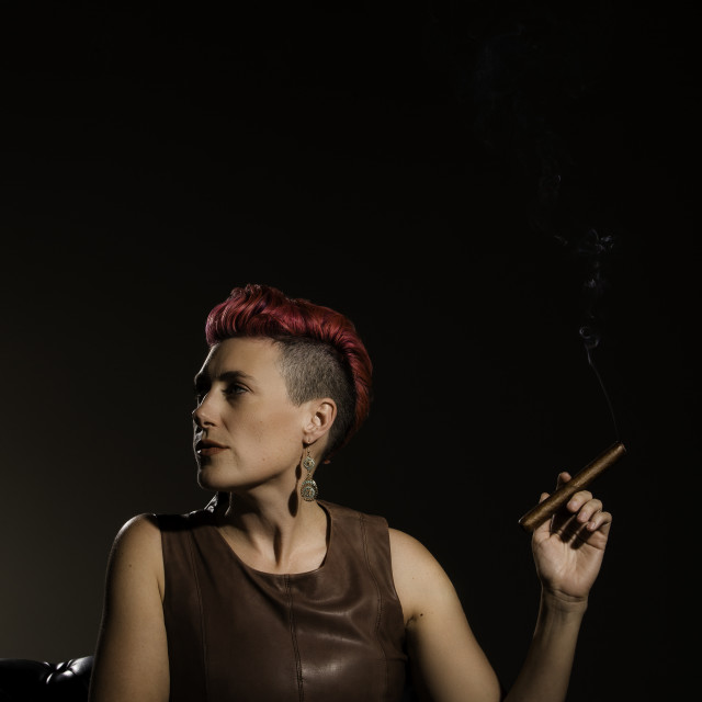 """Vertical Shot of Modern Woman with a Lit Cigar"" stock image"