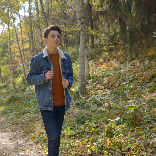 """Teenager in the autumn path"" stock image"