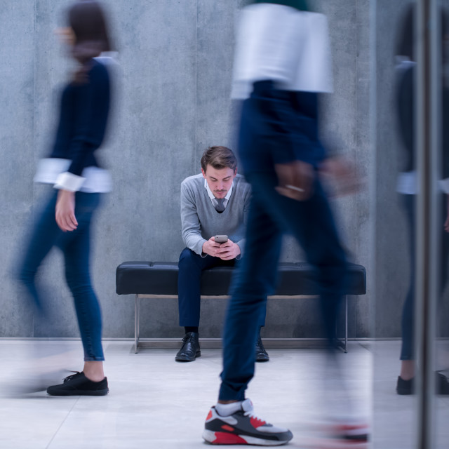 """""""businessman using mobile phone while sitting on the bench"""" stock image"""