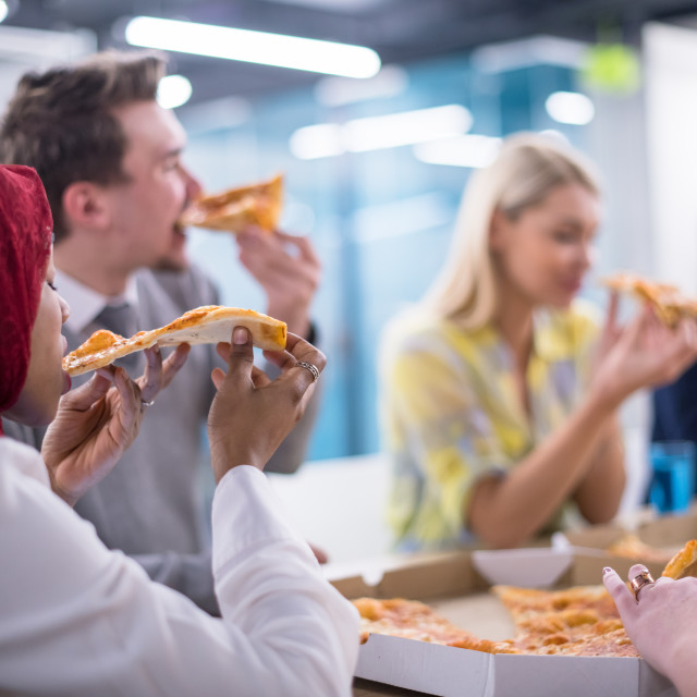 """""""multiethnic business team eating pizza"""" stock image"""