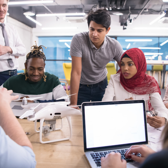 """""""multiethnic business team learning about drone technology"""" stock image"""