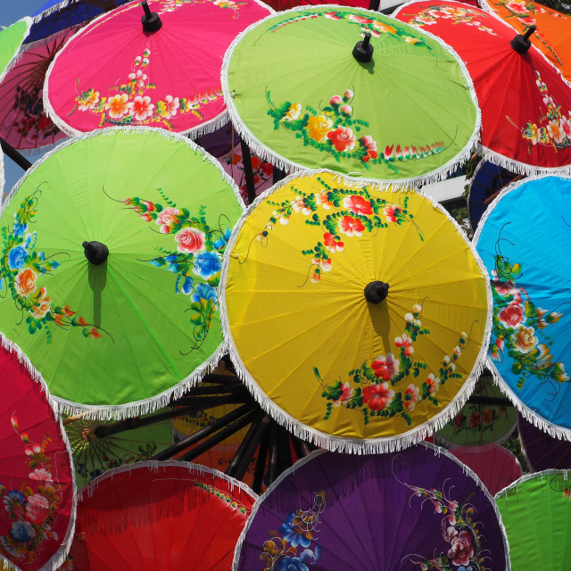 """Colorful umbrellas with flower patterns"" stock image"