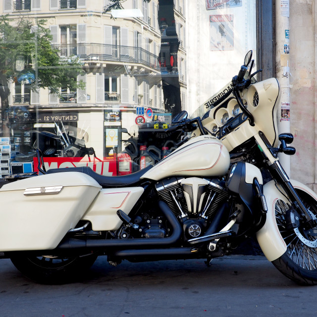 """A Harley Davidson motorbike in front a store in Paris"" stock image"