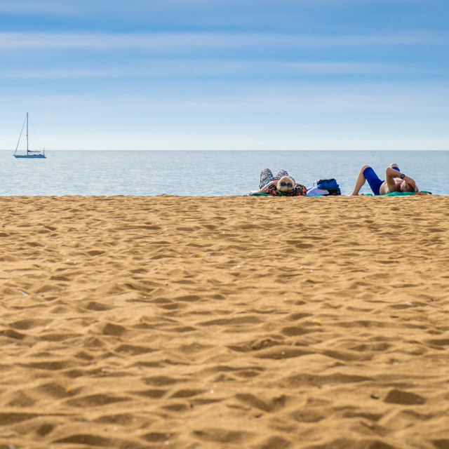 """Lying on an empty beach"" stock image"