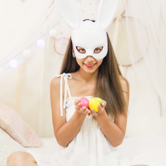 """brunette woman with bunny mask hold easter eggs"" stock image"