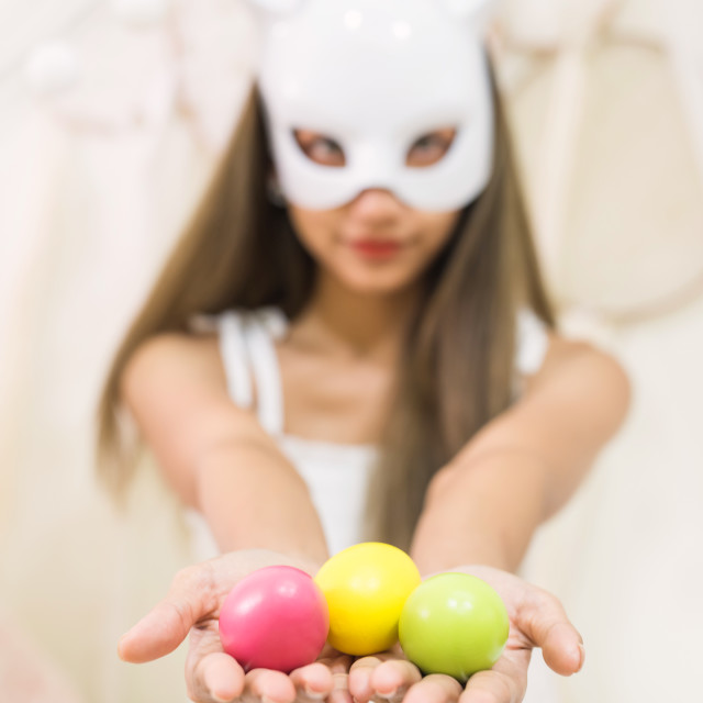 """easter eggs with girl and bunny mask"" stock image"