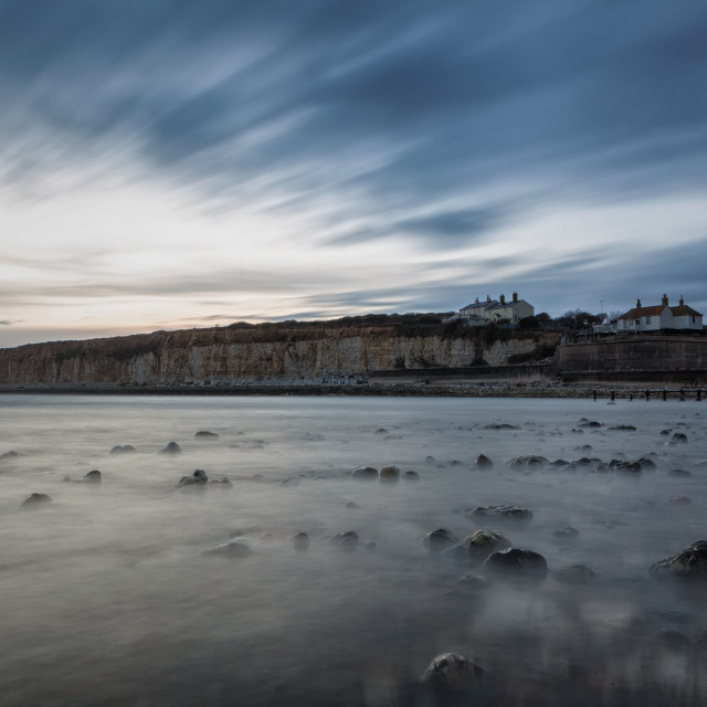 """Coastguard Cottages Long exposure from the advancing sea"" stock image"
