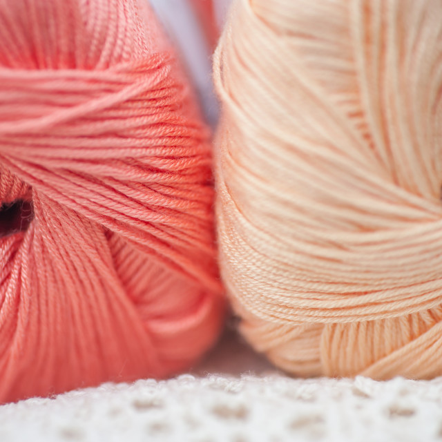 """Two skeins of bamboo thread of living coral and creamy beige col"" stock image"