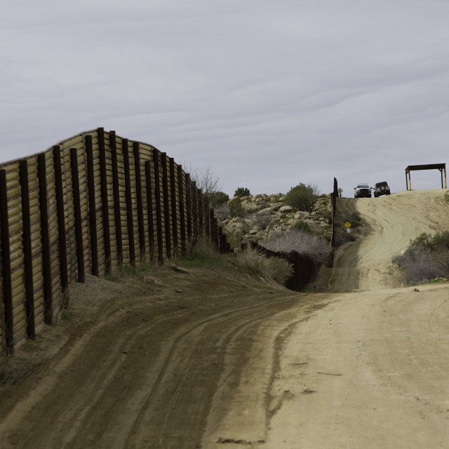 """Border Patrol Vehicles Near Barrier Wall in California"" stock image"