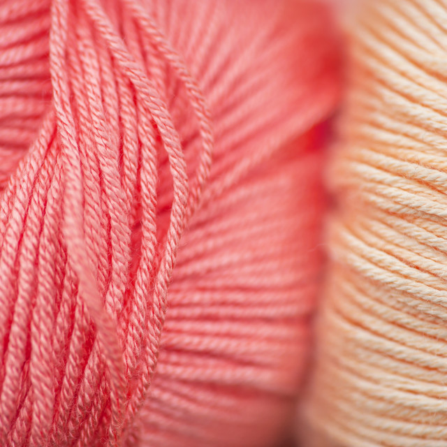"""Skeins of bamboo thread of living coral and creamy beige macro"" stock image"