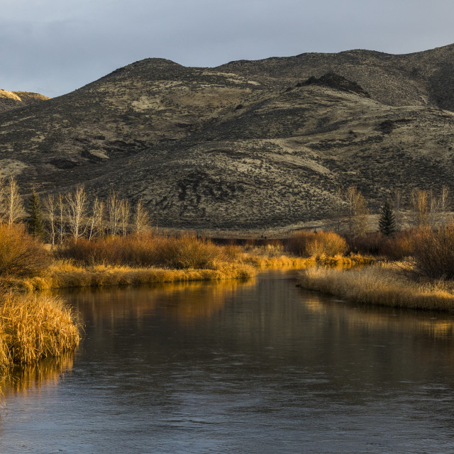 """""""River and hill in Picabo, Idaho"""" stock image"""