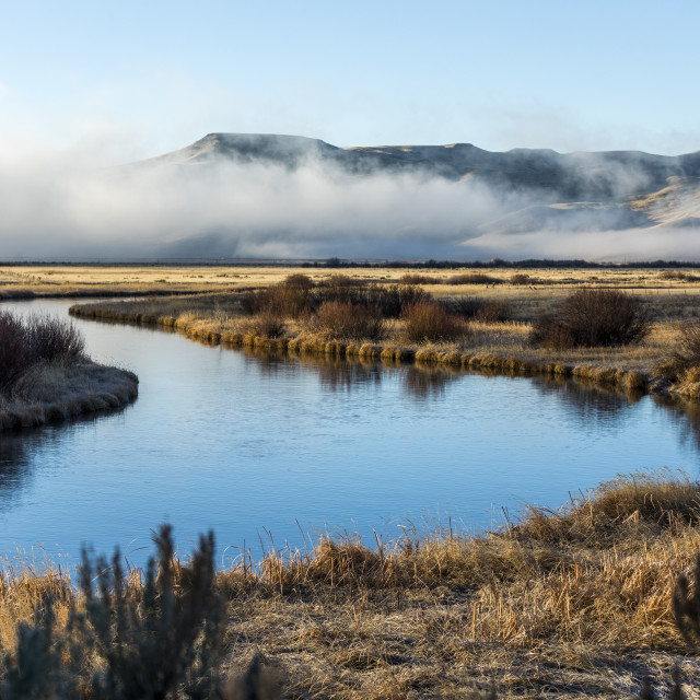 """""""River and mountain under fog in Picabo, Idaho"""" stock image"""