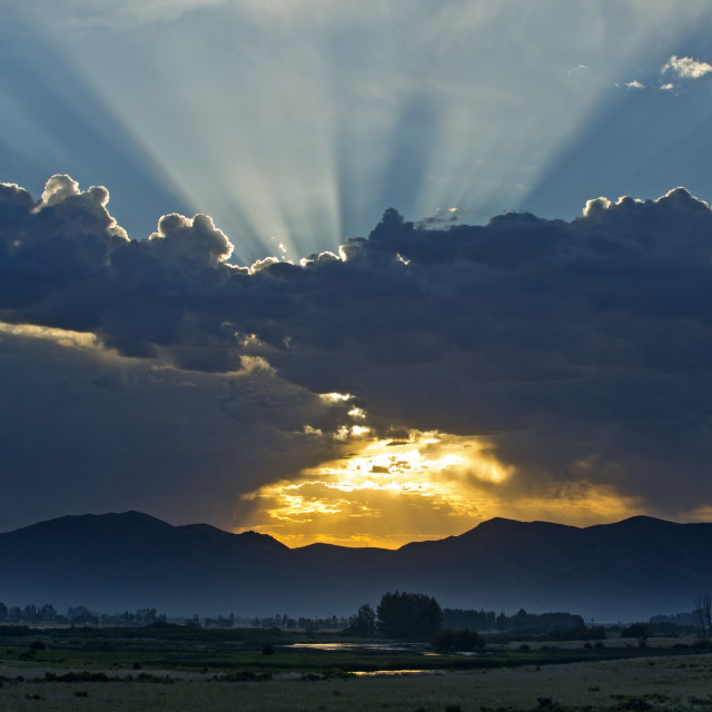 """""""Clouds and sunrise over mountains in Picabo, Idaho"""" stock image"""