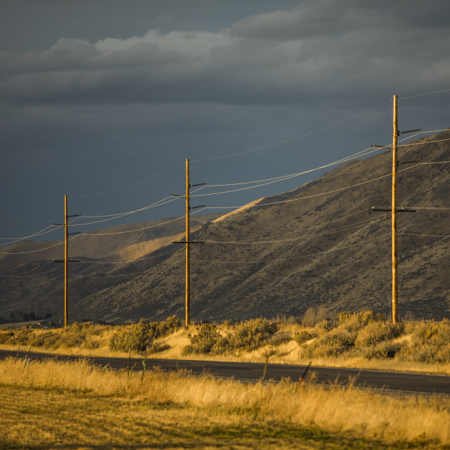 """""""Power lines by hill in Bellevue, Idaho"""" stock image"""