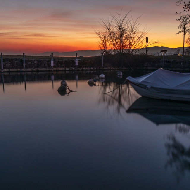 """""""Sunset. Colored. Dock. Evening. Water. Boat. Lake"""" stock image"""