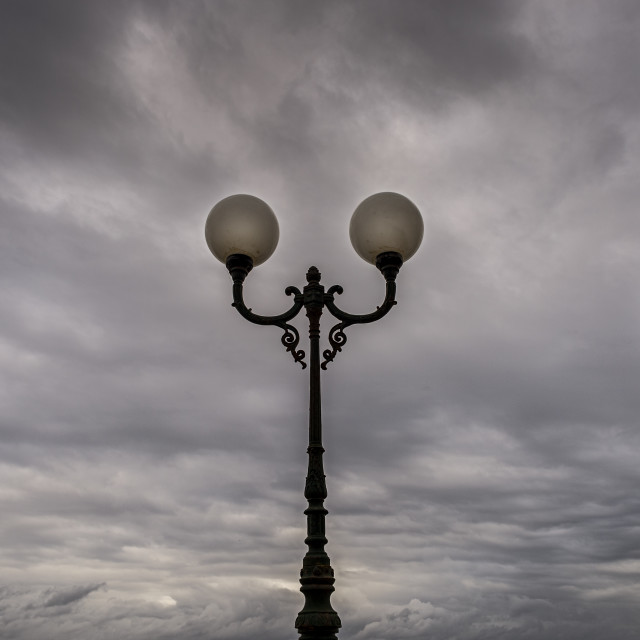"""""""Moody sky with ornate lampost, Malta."""" stock image"""