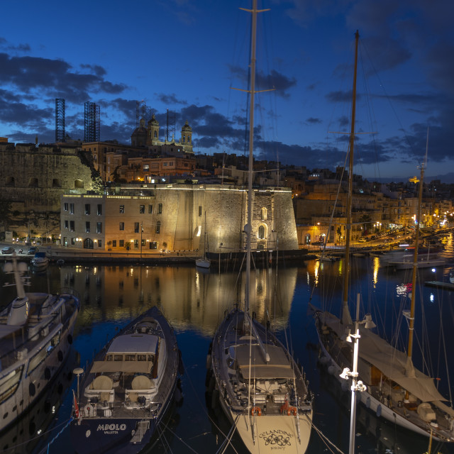 """""""View across the harbour from Vittoriosa to Senglea at dusk with yachts moored."""" stock image"""