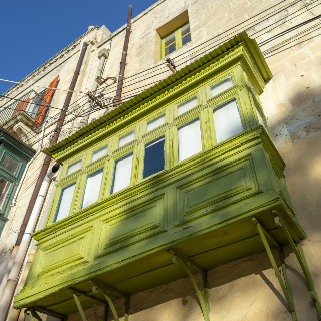 """traditional wooden enclosed balcony in Mdina, Malta"" stock image"