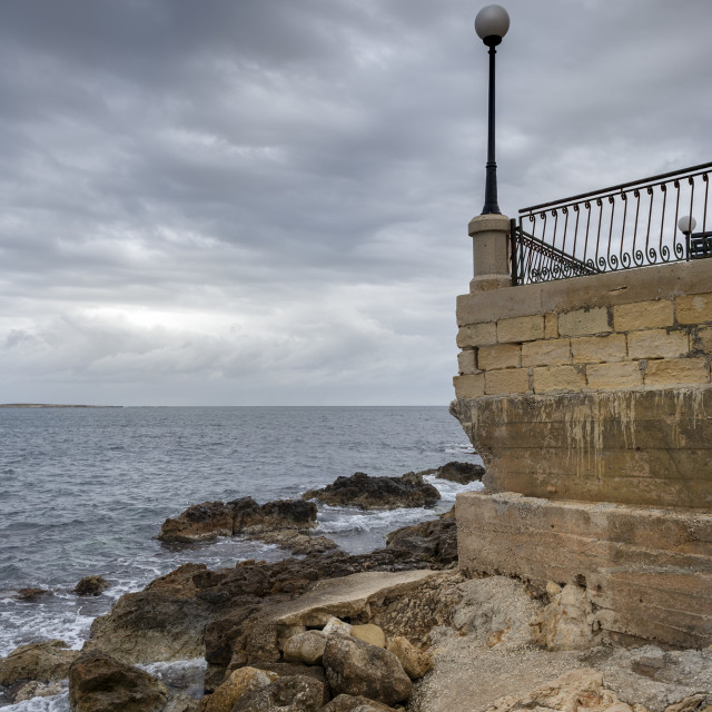 """""""stormy clouds over the water at St Paul's Bay, Malta."""" stock image"""