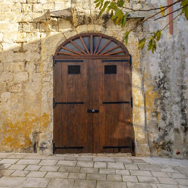 """beautiful wooden door in the ancient walled city of Mdina, Malta"" stock image"