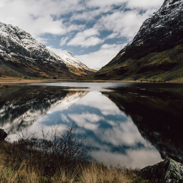 """Loch Achtriochtan reflections winter snow mountain landscape in"" stock image"