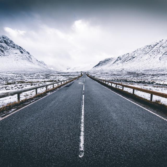 """Open road winter snow mountain landscape in Glencoe Scotland"" stock image"