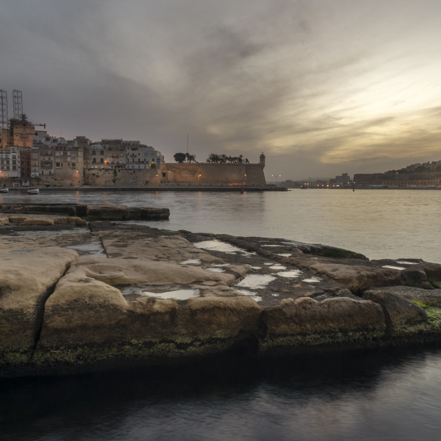 """""""View across the harbour from Vittoriosa to Senglea, Malta, at dusk"""" stock image"""