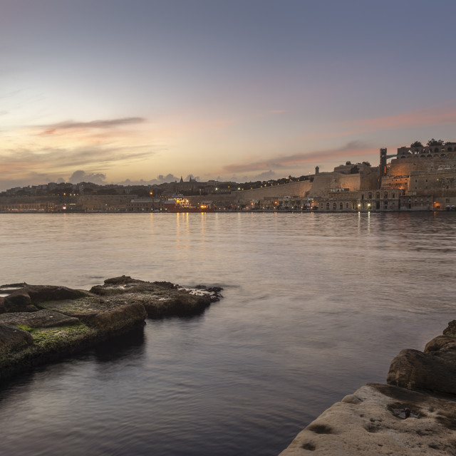 """Valletta, Malta at dusk, viewed across the harbour from Vittoria."" stock image"