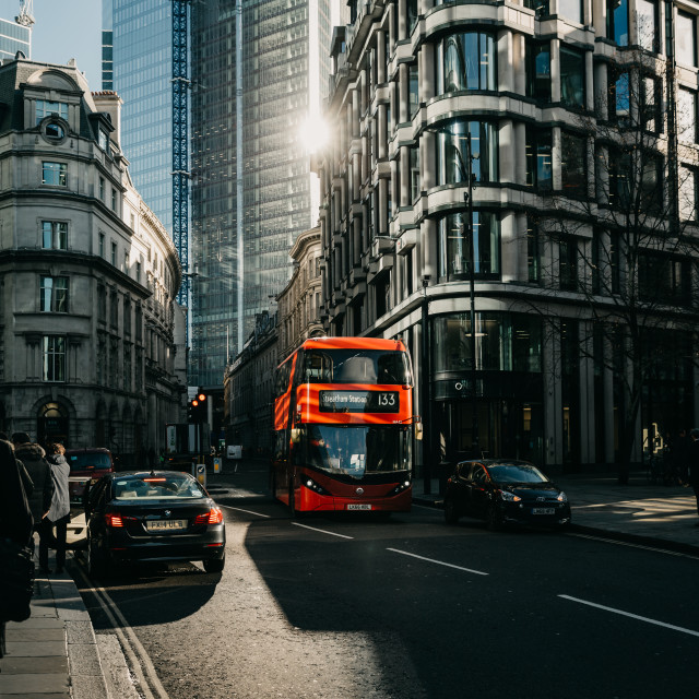 """The game of the sun light in the London street with the typical red bus of the London public transport"" stock image"