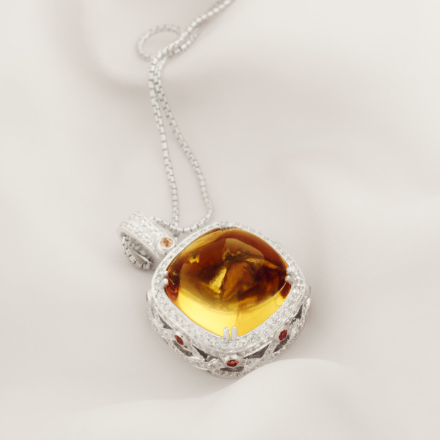 """White Gold Pendat With Citrine And Diamonds"" stock image"
