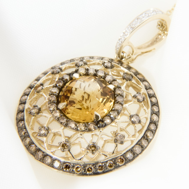 """Yellow Gold Pendant With Citrine And Diamonds On Soft White"" stock image"