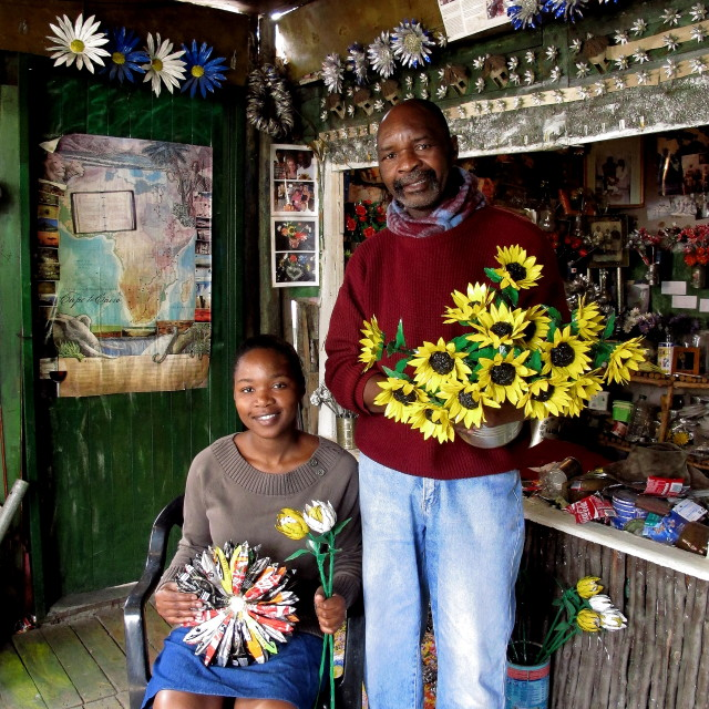 """South Africa and Father and Daughter holding Flowers"" stock image"