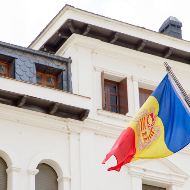 """La Vella, Andorra. A Flag of Andorra hanging out in a street"" stock image"