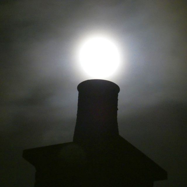 """Supermoon over cotswolds chimney"" stock image"