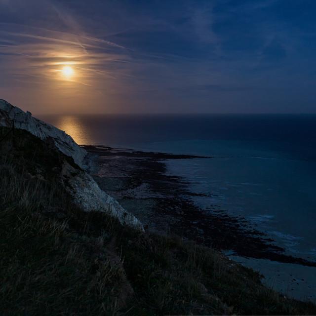 """Snow Moon from Beachy Head"" stock image"
