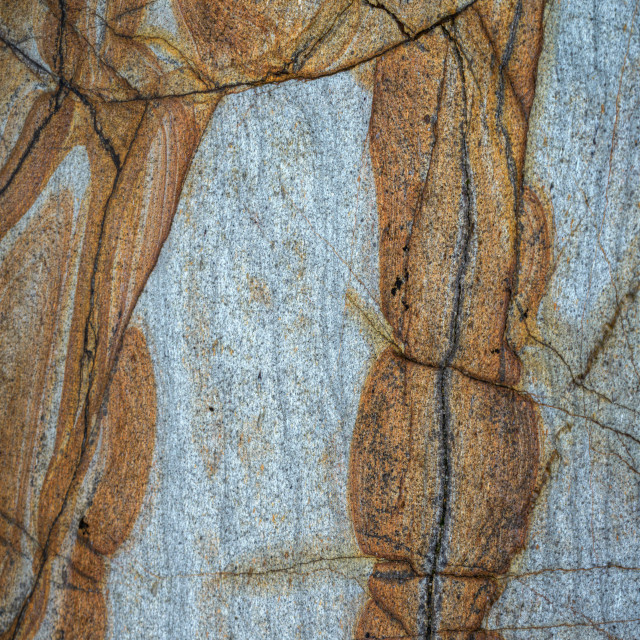 """""""Orange patterns formed by filtrations of a ferric vein in a blue slate rock, on a beach of Loiba, north coast of Galicia"""" stock image"""