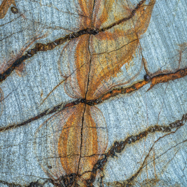 """""""Reddish texture formed by filtrations of a ferric vein in a slat"""" stock image"""