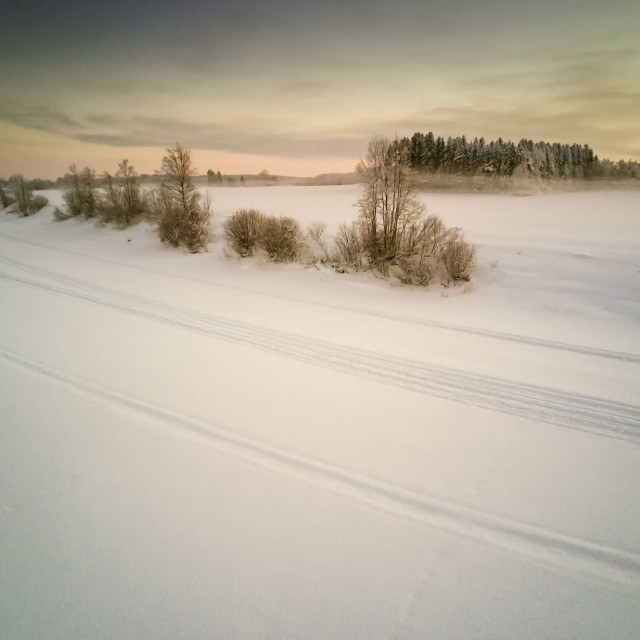 """""""Snow Mobile Tracks On An Icy River"""" stock image"""