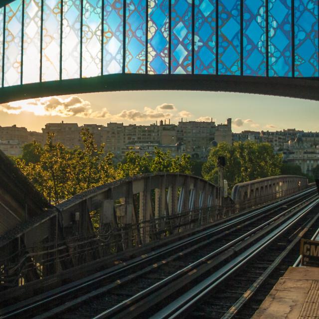 """Old metro tram station in Paris sunset sunlight evening rails"" stock image"