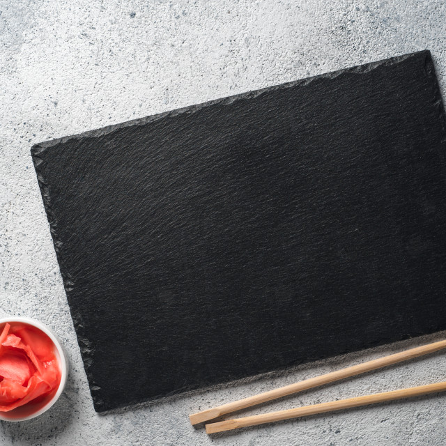 """""""Empty slate with chopsticks and pickled ginger"""" stock image"""