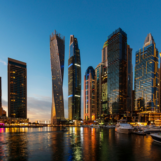"""""""Dubai marina modern scene of skyscrapers and luxury yachts at blue hour"""" stock image"""