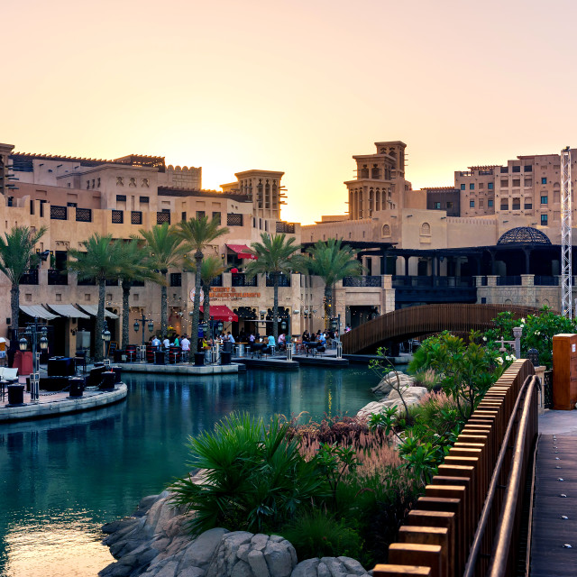 """Dubai, United Arab Emirates - April 20, 2018: Sunset view at Madinat Jumeirah resort and restaurants, leisure travel spot in Dubai"" stock image"