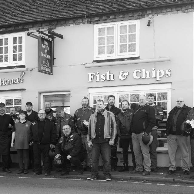 """Gathering Outside Steve's Chippy"" stock image"